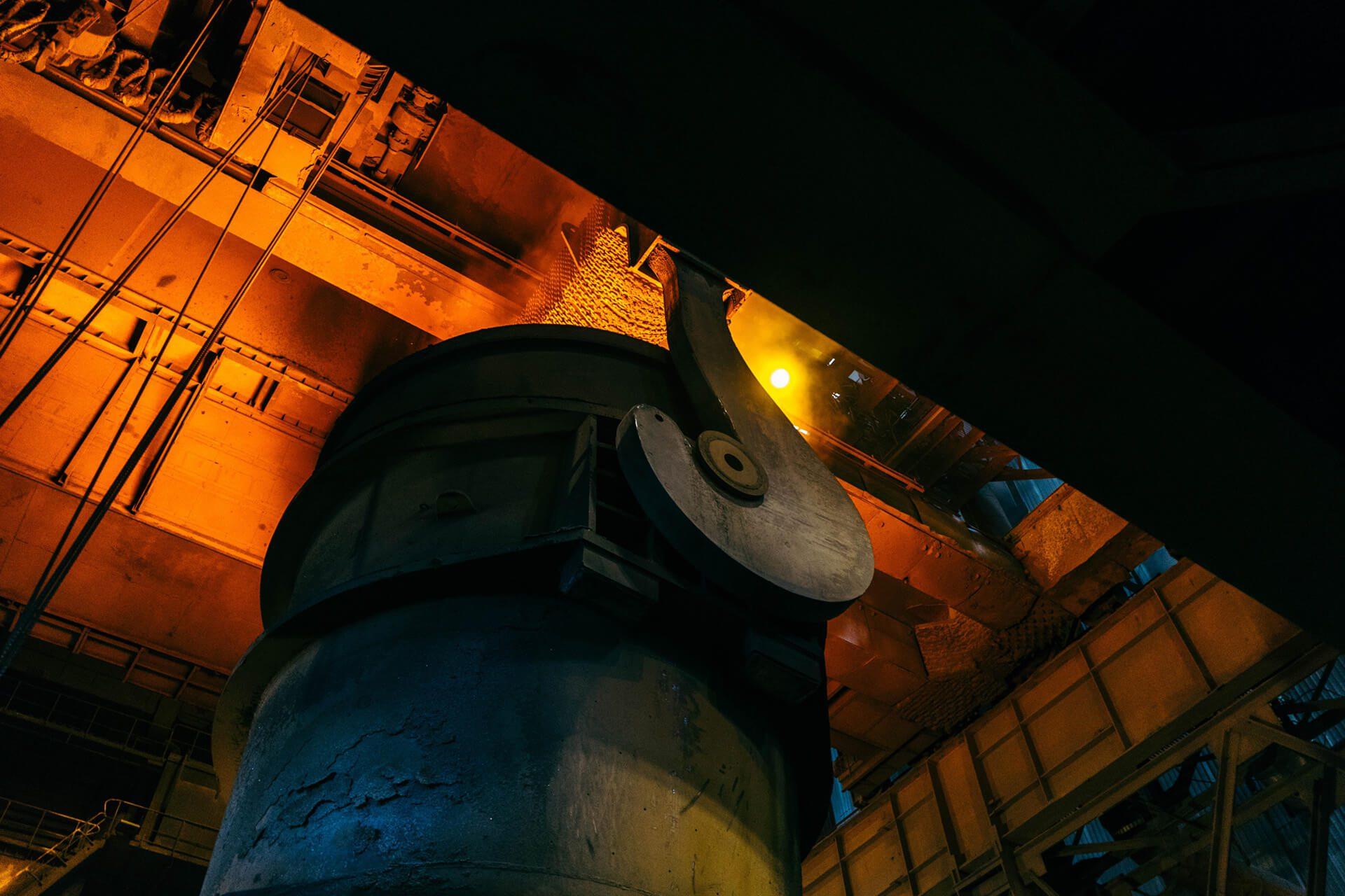 Ladle carrying molten steel in steelmaking plant.